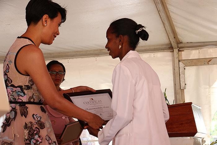 Handed the award of excellence by Madagascar's First Lady