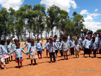 Children celebrating the inauguration of their school in Fiarenana, Madagascar – Zahana.org