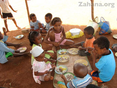 celebrating the inauguration of their school in Fiarenana, Madagascar with food– Zahana.org