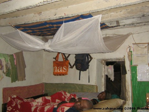 Using the mosquito net in the house_in_Fiadanana_Madagascar