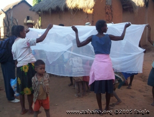 Demonstrating mosquito net use 2