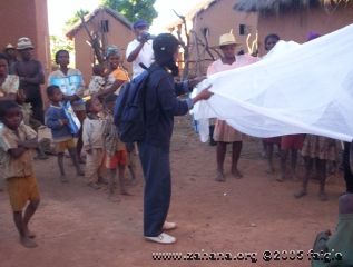 Demonstrating mosquito net use