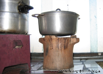 cookig rice on a charcoal stove in kitchen in Antananarivo
