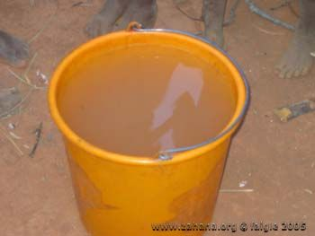 Yellow bucket with water