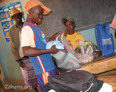 checking out the stuff fo secondaty school in Madagascar zahana.org