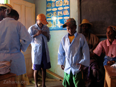 trying on the school uniforms in Madagascar - zahana.org
