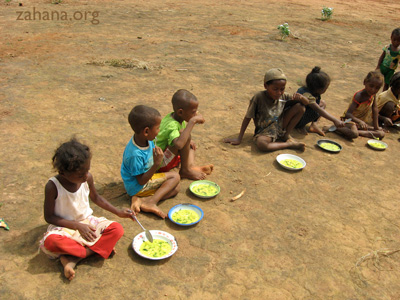 eating soup in the school yard in madagascar